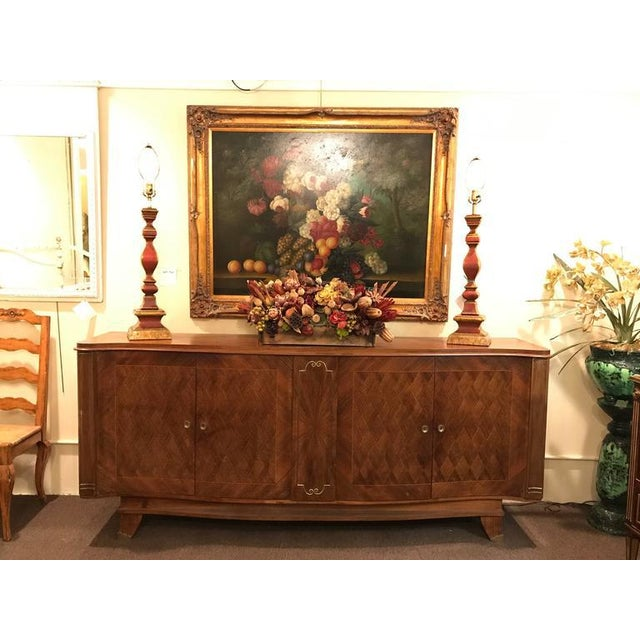 Gaessiar Ebenistes French, circa 1930 Sideboard. Parquetry fronts with fitted interior. The small bronze sabot feet...