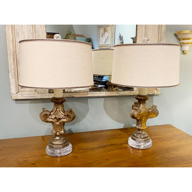 """A pair of Antique fragments mounted on new lucite bases as lamps. With Shades Shades - 14"""" Wide 8.5"""" High Overall 8"""" Wide..."""