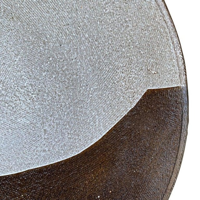 A fantastic set of eight hand-thrown dark brown stoneware dinner plates each with a unique bold white slip-glaze motif,...