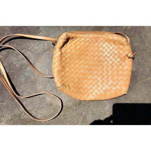 1980s Bottega Veneta tan cross body bag. Bottega Veneta's infamous Intrecciato is Italian for 'braided', of course. But...