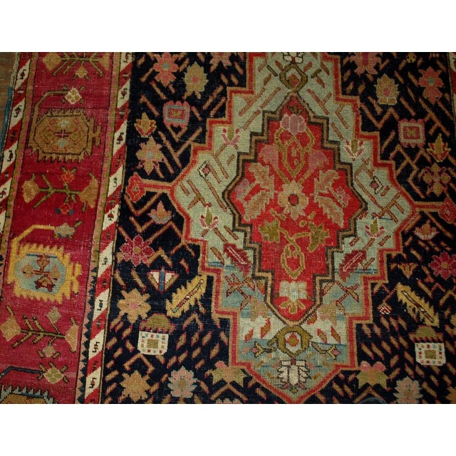 Antique hand made Russian Karabagh rug in great condition. The rug has black background with large charming diamond shaped...