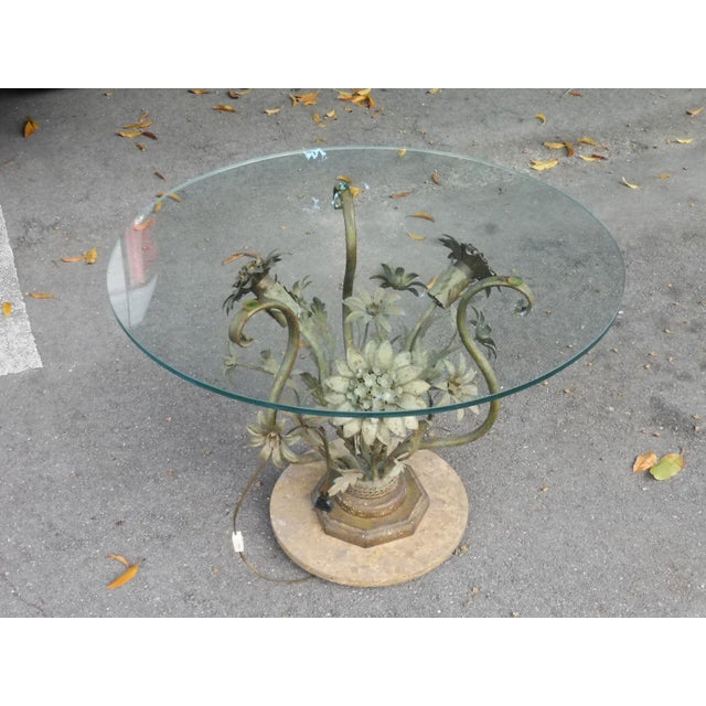 Vintage Hollywood Regency tole flower table with marble base sold as found in vintage condition showing normal signs of...