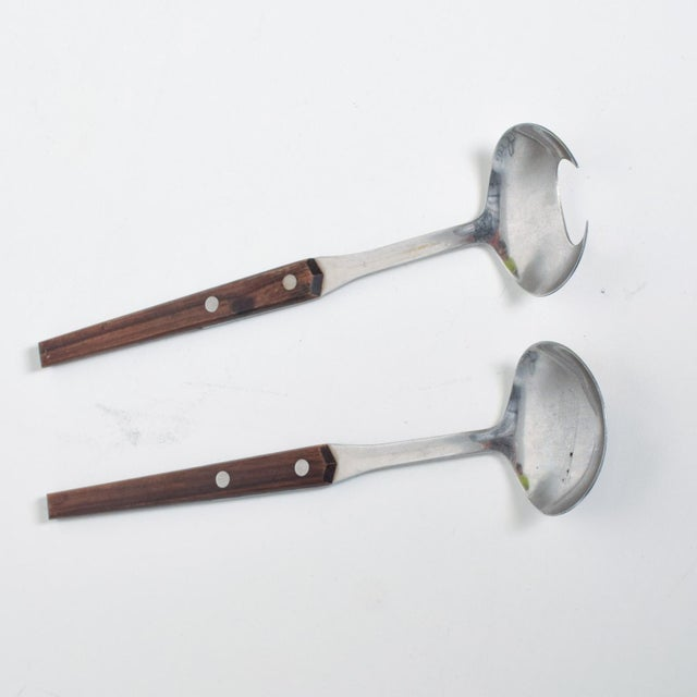 We are pleased to offer for your consideration a set of salad servers. Constructed with stainless steel and rosewood....