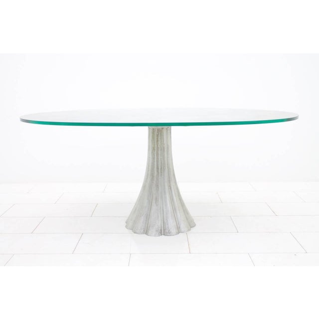 Elegant dining table with oval mirrored glass top with marble effect and metal cast foot from italy 1960s. Measures: W 175...