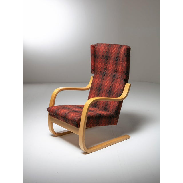 Pair of lounge chairs model 401 by Alvar Aalto for Artek. Bent laminated birch frame and tartan fabric for this iconic...