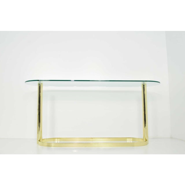 Elegant console in brass finish and glass top by Pace. Very well made. Brass finish is shiny and shows very nicely.