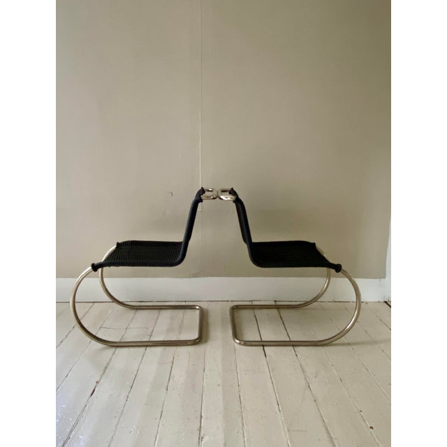 Pair of Mies Van Der Rohe side chairs with handwoven, hard-to-find, ebonized cane seat and back. There is a protective...