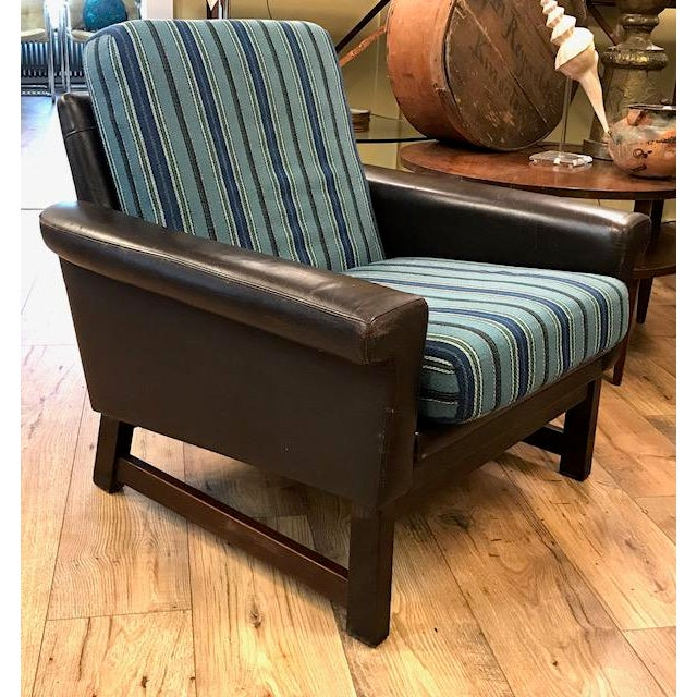 Great from and an interesting combination of texture and color. This mid century brown leather chair sits on a relaxed...