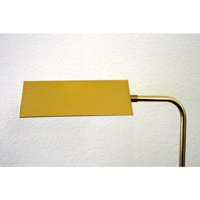 Brass-plated pharmacy floor lamp with triangular shade on an adjustable pole. Original wiring is in working condition....