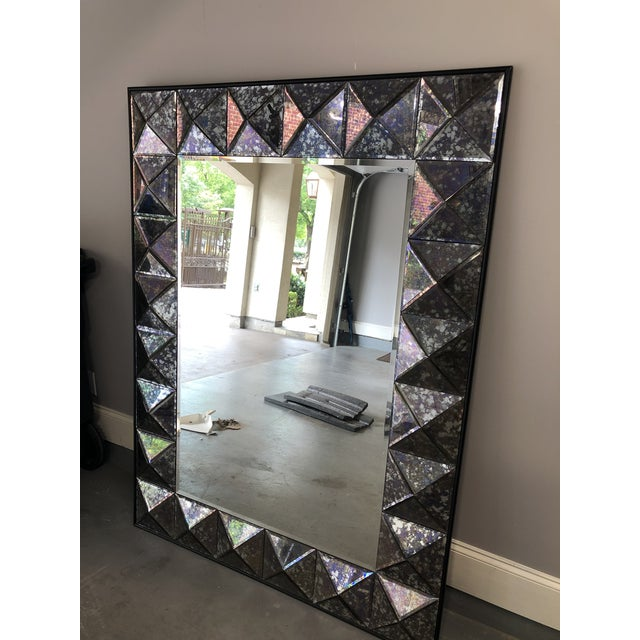 This gorgeous mirror brings a touch of glamour to any space. The faceted frame is made of antique glass in a shade of...