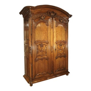 "Early 1700's French Walnut Wood Chateau Armoire, ""The Order of Saint Louis"" For Sale"