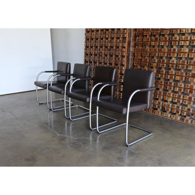 Set of four brown leather armchairs by Antonio Citterio & Glen Oliver Low for Vitra, 1999.