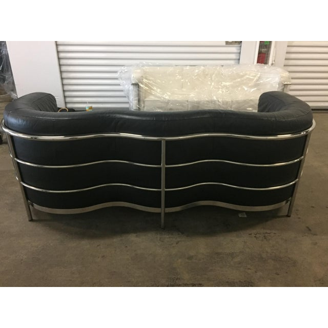 black leather and chrome - iconic and stately - this sofa was in a guest bedroom and so perfect ; all chrome is...