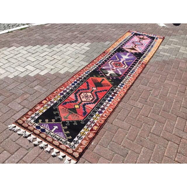 This gorgeous hand knotted vintage Anatolian area rug is approximately 70 years old in excellent vintage condition. The...