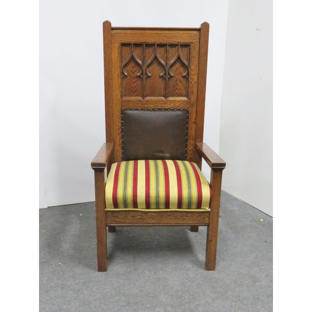 Early 1900's carved oak gothic style throne chair.