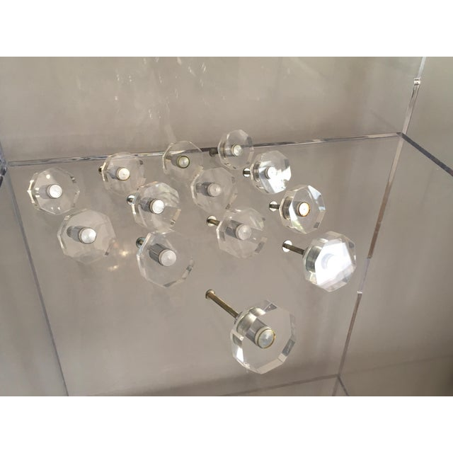 Vintage group of thirteen hexagonal Lucite cabinet or drawer knobs with silver tone metal hardware.