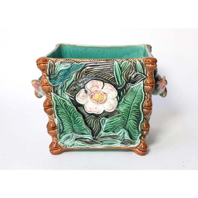 Antique French majolica Palissy square jardinière, circa 1800s. Two opposing sides with fish, flowers and green leaves,...