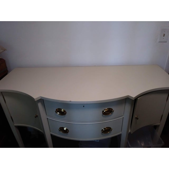 This Hickory Chair company hepplewhite-style Federal cream-colored sideboard is a classic. It features two dovetail...