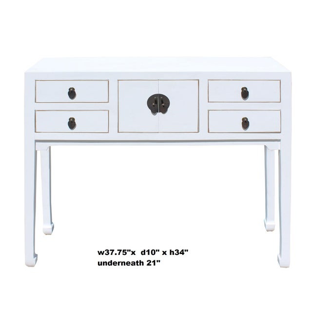 This is a simple distressed off white lacquer console side table with straight leg design. Drawers are decorated with...