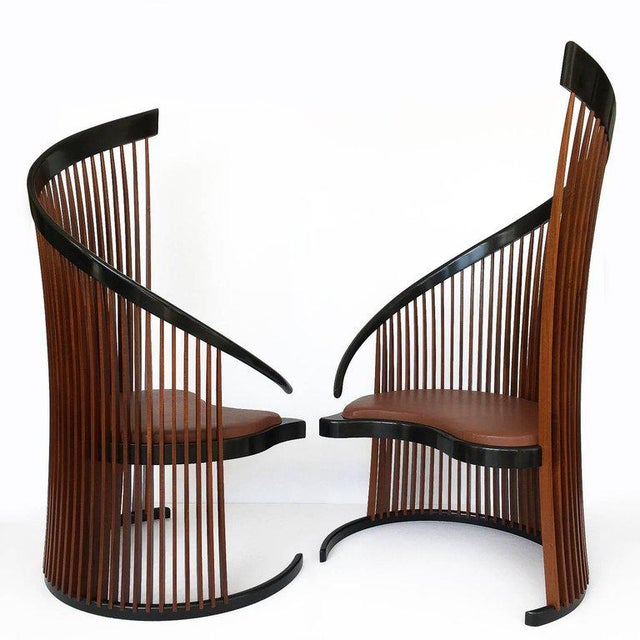 American Studio Craft Movement pair of Paso Doble sculptural high back slatted chairs by Thomas Stender. These identical...