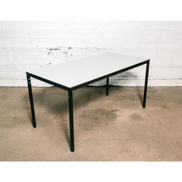 "Dining table by Dutch designer Friso Kramer. Light gray composite top on black metal frame. Size: 29""H x 59""W x 30""D..."