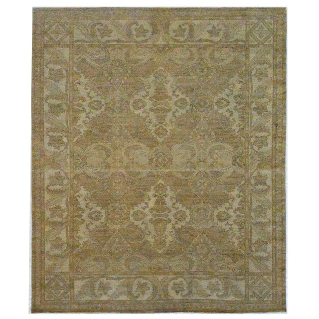Created in Pakistan, this magnificently decorative rug features a beautiful panel design and a masterful color...
