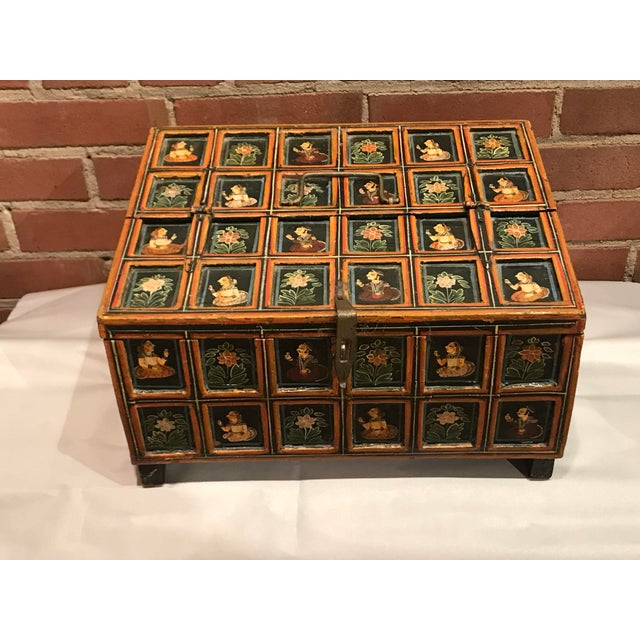 I love this hand painted Indian Folk Art footed box with brass handles. Its funcional and decorative and adds a pop to any...