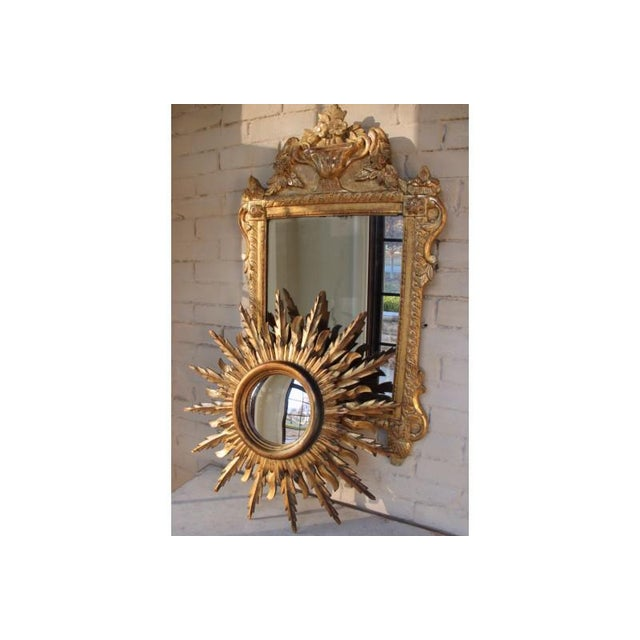 A stunning midcentury French sunburst mirror, circa 1930 with rays arranged in a double layer pattern. Original mirror...