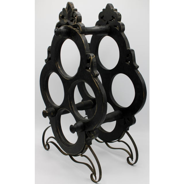 A superb vintage black oak wine rack with sturdy metal legs that holds 4 wine bottles. This is a unique and attractive...