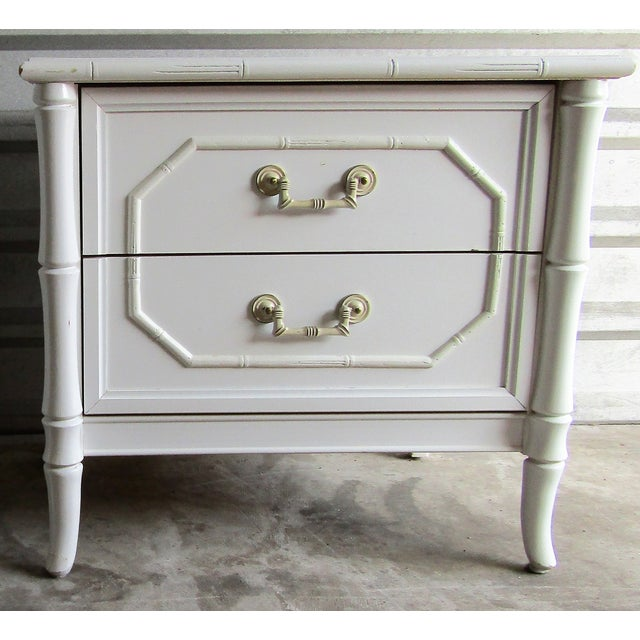 Solid , Heavy and Well Made Pair of Nightstands. This pair feature faux Bamboo Fronts , Two Drawers and great bamboo...