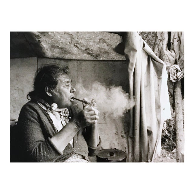 """Vintage 1966 """"Canadian Cree Woman Lights Her Pipe"""" Photograph by Paul S. Conklin For Sale"""