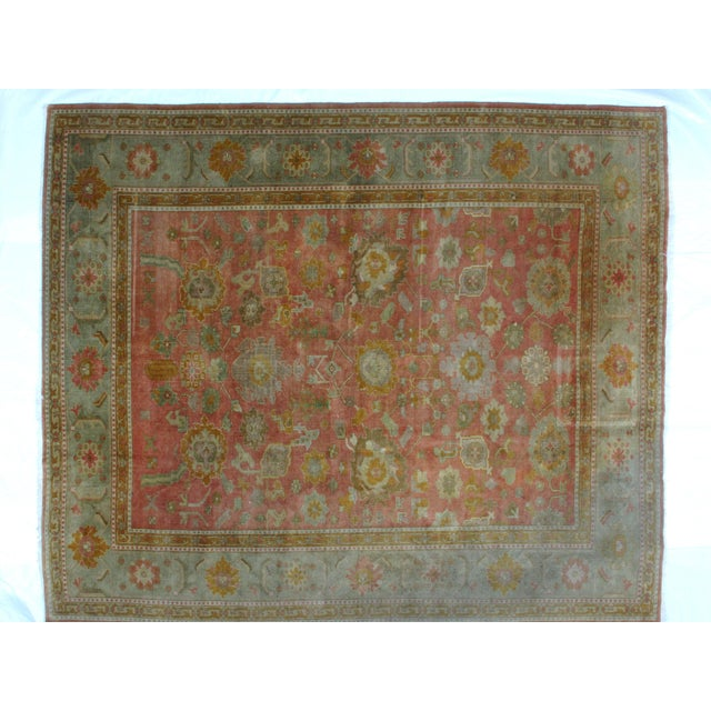 This master piece is a wool on wool pile hand woven Turkish Oushak carpet with minor wear.