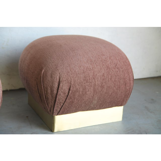Great pair of poufs in the style of Karl Springer. New upholstery.