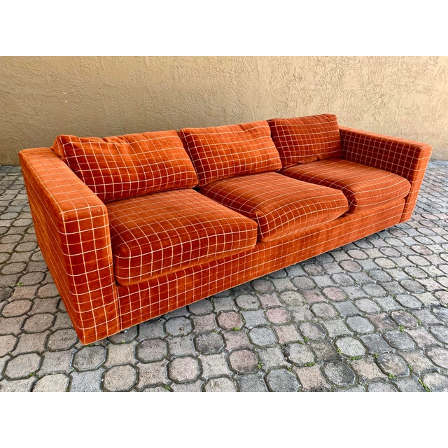 Fantastic long stretched lounge 70s sofa! Very comfortable to sit in and can comfortably seat five people. Sofa stands on...
