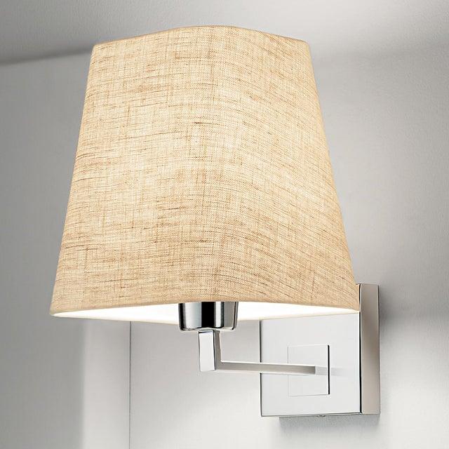 "Polished chrome wall light with linen shade. Certification: IP20. Bulb: 1 x E27 7W LED 2700K Width: 3.9"" Depth: 9.4""..."