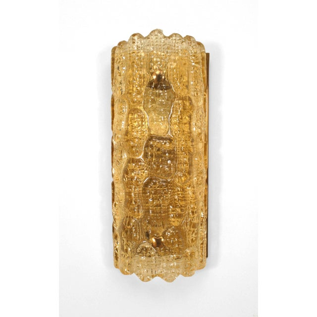 """Pair of Swedish (Orrefors) mid-20th century """"crocodile"""" textured amber glass wall sconces with a cylindrical form and..."""