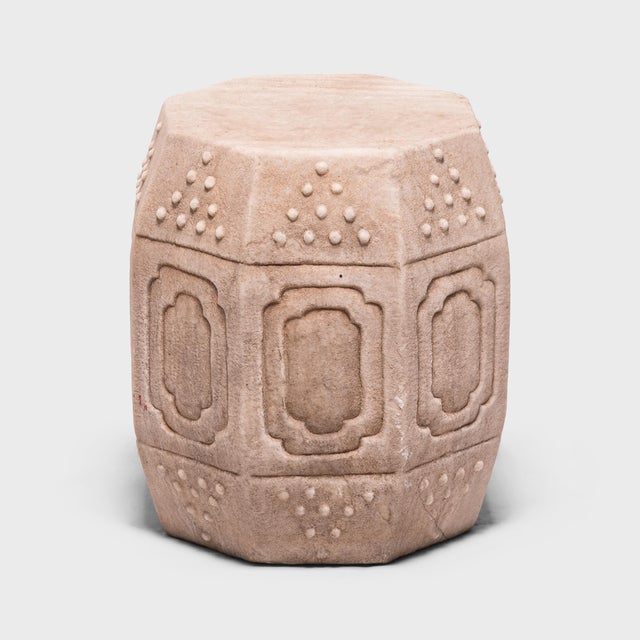 Hand-carved of solid marble, this early 20th-century drum-form stool has eight sides, an auspicious number symbolizing...