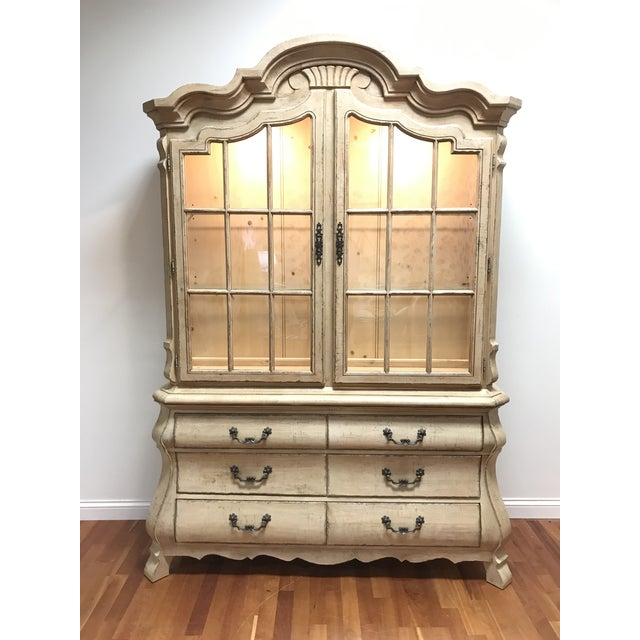 585-599D Studio Pine by Drexel Heritage lighted China cabinet with white washed rustic finish. Cabinet consisted of two...