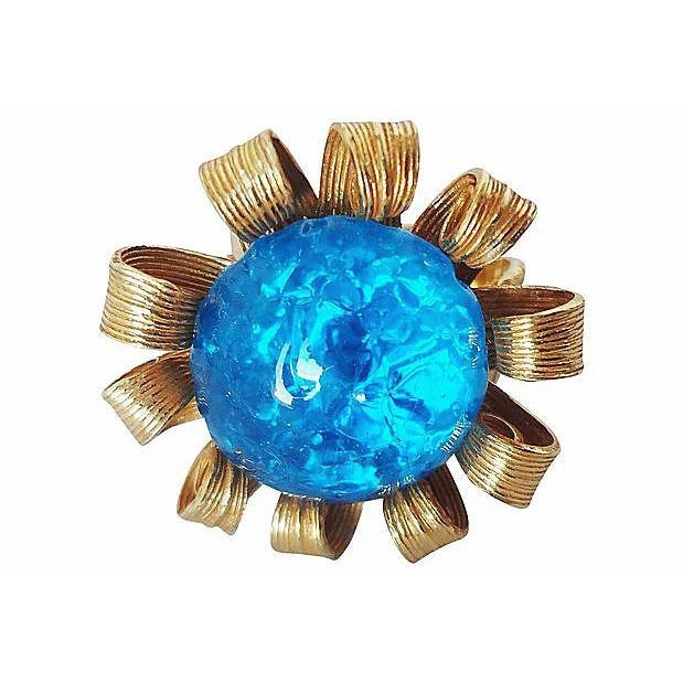 1980s Goldtone blue art glass cabochon adjustable ring. Unmarked. Condition: Very Good; some wear to back & band Measures:...