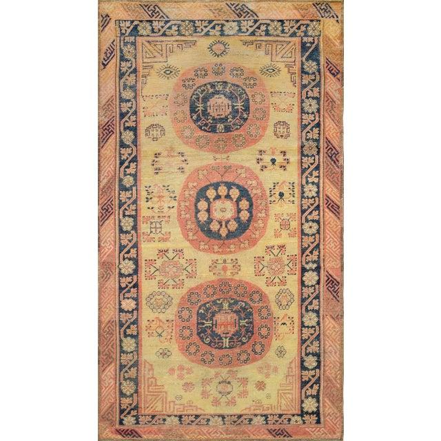 Vintage Handwoven Wool Khotan Rug For Sale