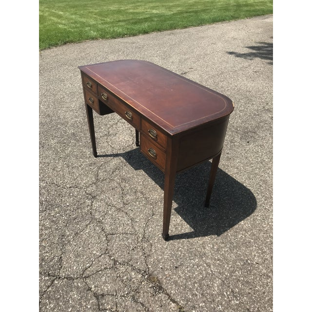 High end writing desk by baker furniture loaded with character. Leather pad on top. Curved finished back so desk can float...