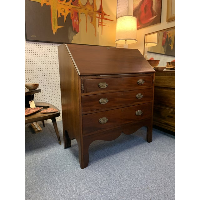 English c 1890's Hepplewhite style Chippendale mahogany drop front desk. Drop front with leather top, 7 cubbyholes and 4...