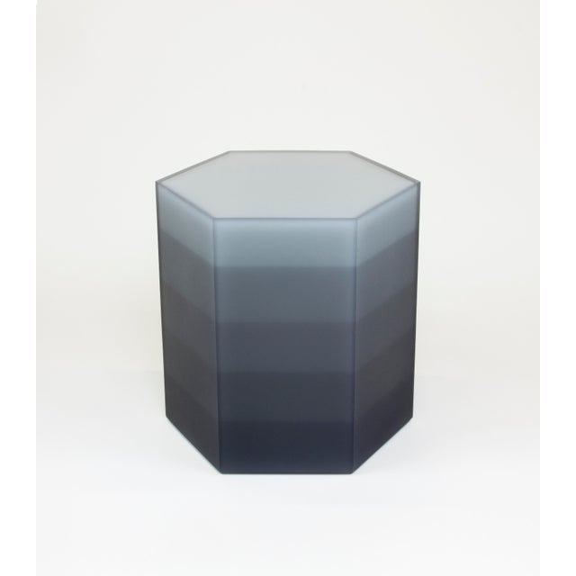 This stool / side table uses Facture Studio's gradient style to transition in five layers from a deep opaque to water...
