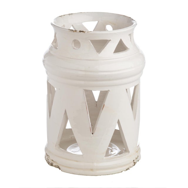 The lantern is as old as time, and no color is as classic as stark white. The cutouts on this lantern give a modern twist...