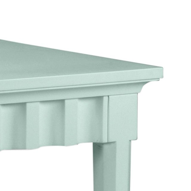 Scallop pattern design on console and finish is Benjamin Moore Palladian Blue. Made of acacia wood.