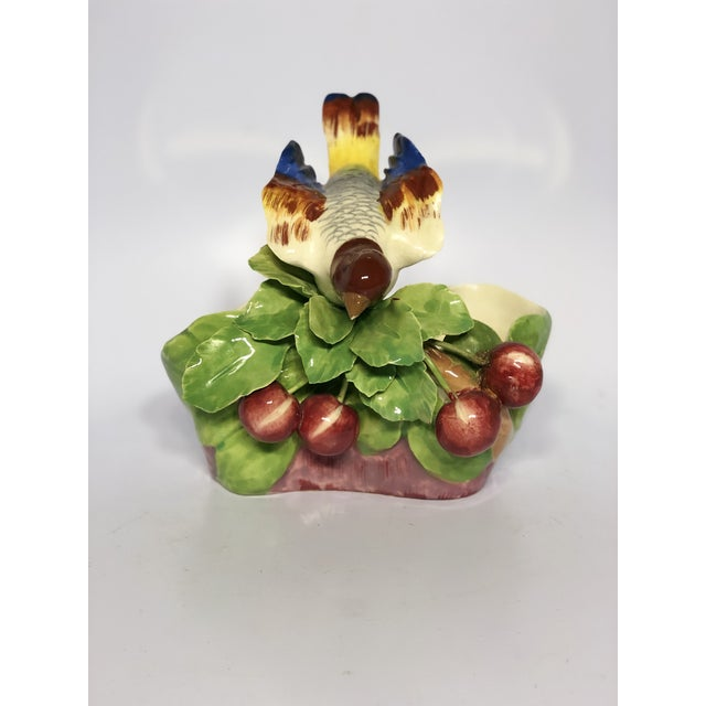 This colorful Majolica planter was crafted in Italy. Features a song bird perched on leaves that are embellished with...