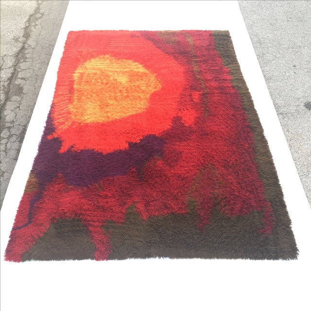 Rare and incredible RYA rug in very good condition. Wonderful colors and abstract design. Measures just under 8 x 11'....