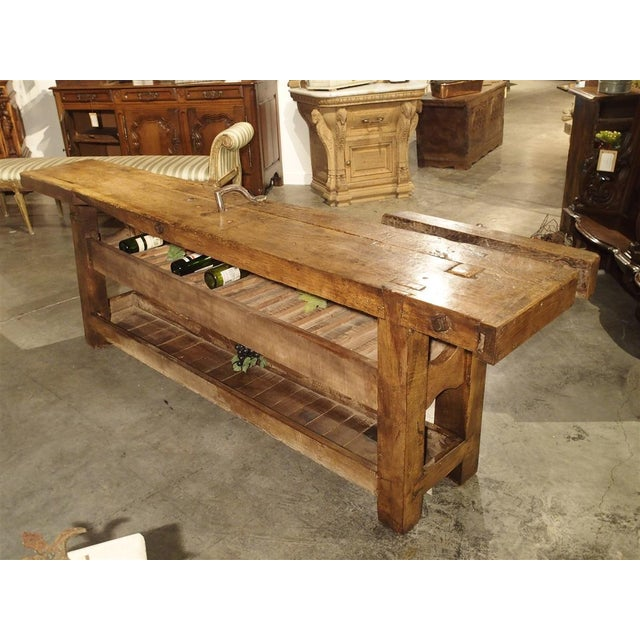 From France, this charming antique workbench has been converted into a large wine bottle holder. The workbench top still...