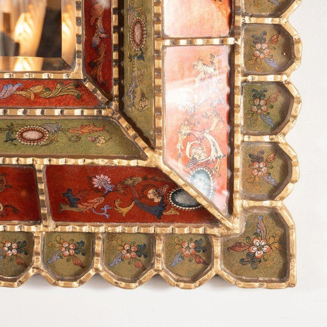 This refined and sophisticated shadowbox mirror was realized in Venice, Italy circa 1950. Its perimeter consists of a...