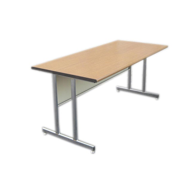 """Excellent condition preowned desk by HON. Chrome metal legs and frame. Wood veneer table top surface. Dimensions: 66""""l X..."""